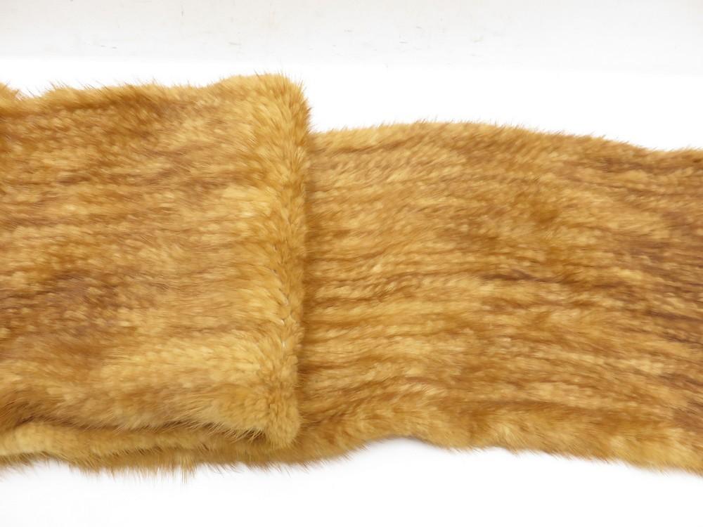 écharpe vison tricote